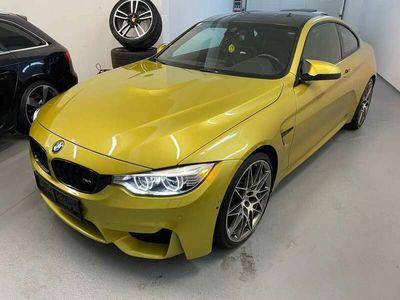 gebraucht BMW M4 DKG Competition Austingelb Carbondach