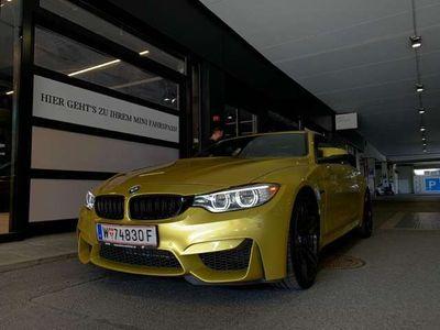 gebraucht BMW M4 M-DKG Coupe Aut. *PHÖINXGELB*