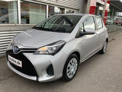 brugt Toyota Yaris Hybrid 1,5 Hybrid E-CVT 100HK 5d Trinl. Gear A+++ Bliv ringet opSkriv til os