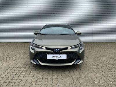 brugt Toyota Corolla Touring Sports 1,8 Hybrid Essential E-CVT 122HK Stc Trinl. Gear A+