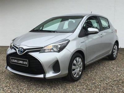 brugt Toyota Yaris Hybrid 1,5 B/EL E-CVT 100HK 5d Trinl. Gear A++