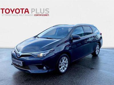 brugt Toyota Auris Touring Sports 1,8 B/EL H2 Comfort Safety Sense 136HK Stc Aut. A++