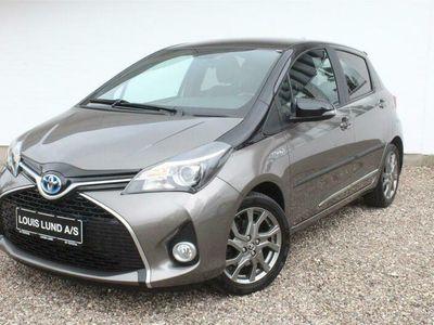 brugt Toyota Yaris 1,5 B/EL Delight E-CVT 100HK 5d Trinl. Gear A++