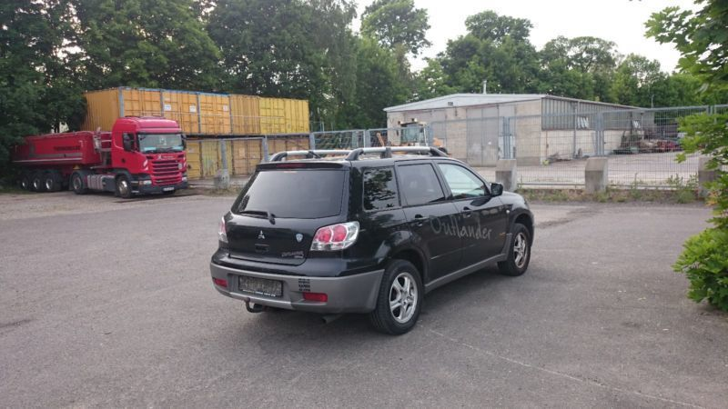 verkauft mitsubishi outlander 2 0 spor gebraucht 2003 km in luckau. Black Bedroom Furniture Sets. Home Design Ideas