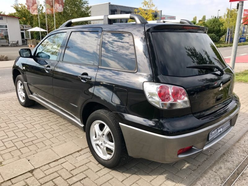 verkauft mitsubishi outlander 2 4 spor gebraucht 2004 km in worms. Black Bedroom Furniture Sets. Home Design Ideas