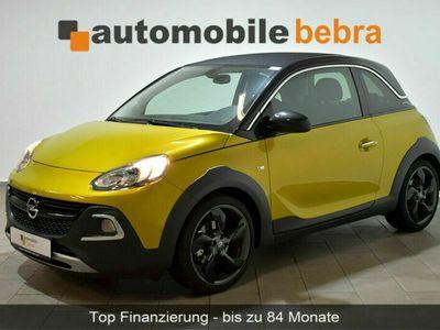 gebraucht Opel Adam 1.0TSI Rocks Panor.-Temp.-CD-Navi-SHZ-8xAlu