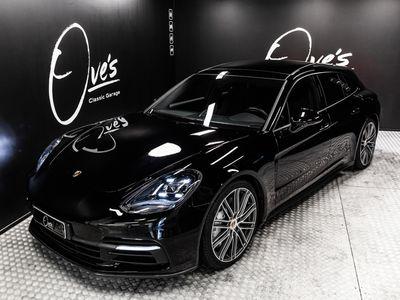 käytetty Porsche Panamera 4 E-Hybrid Sport Turismo, 21 ja 20 alumiinivanteet, panoraamalasikatto, ilmajousitus, Sport Chrono, uutta vastaava