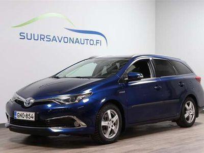 käytetty Toyota Auris Touring Sports 1,8 Hybrid Premium **HYVÄT VARUSTEET - 12kk MAKSUTON APPROVED LISÄTURVA**