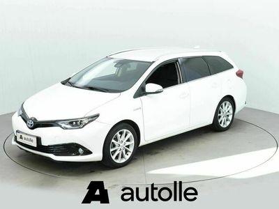 käytetty Toyota Auris Touring Sports 1,8 Hybrid ActiveEdt(18.2 - Näyttävä hybridi 1-omistajalta