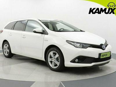 käytetty Toyota Auris Touring Sports 1,8 Hybrid Premium / Tulossa myyntiin / Navi / Vakionopeudensäädin / Peruutuskamera