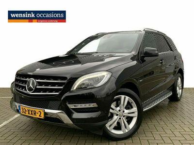tweedehands Mercedes 350 M-KLASSE4MATIC 306pk | Navigatie | Panoramadak | Adaptive cruise control | Leren bekleding | Luchtvering | Elektrische bedienbare trekhaak + achterklep | Xenon koplampen | Memory stoelen | Verwarmde en gekoelde voorstoelen | Achteruitrijcame