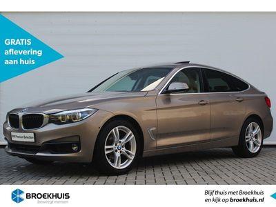 tweedehands BMW 320 3-SERIE Gran Turismo i High Executive Automaat | Panoramadak | Head-up display | Elektrisch verstelbare voorstoelen | Achteruitrijcamera | Sportstoelen | Climate control | Parkeersensoren | Alarm klasse 3