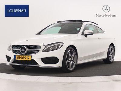 tweedehands Mercedes 180 C-Klasse CoupéPremium Plus, Automaat, Panoramadak, AMG line, Navigatie, Tempomaat, Stoelverwarming voor, Parktronic, Alarm klasse 3, Diamantgrille, LED koplampen high performance.