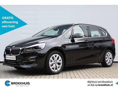 tweedehands BMW 218 2-SERIE Active Tourer i High Executive Automaat | Afneembare trekhaak | Glazen panoramadak | Achteruitrijcamera | Vol leder | Stoelverwarming | Navigatiesysteem plus | Head-up display | Regen&lichtsensor | | Climate control | Cruise control | Led k