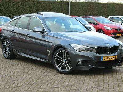 tweedehands BMW 320 3-SERIE Gran Turismo d High Exe. M Sport Pakket / Panoramadak / Zwart Leder / NL Auto! / 108.433 km