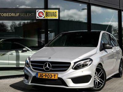 tweedehands Mercedes B180 AMG Night Edition Plus Trekhaak Panoramadak LED Sportpakket Navigatie Bluetooth 122pk Spraaksturing PDC