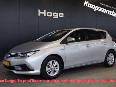 tweedehands Toyota Auris 1.8 Hybrid Now Automaat ECC Rijklaarprijs Inruil M