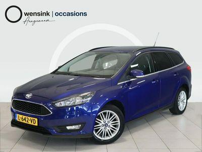 tweedehands Ford Focus Wagon 1.5 Titanium | Climate | Cruise | LED | Navigatie | Privacy Glass | Verw. Stoel | Verw. Stuur | Verw. Voorruit | Bluetooth |