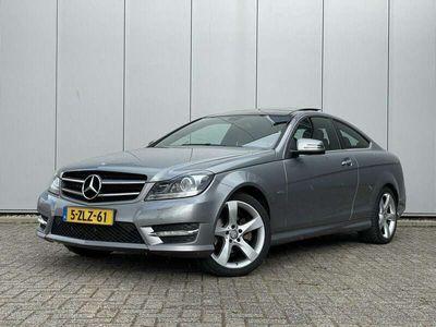 tweedehands Mercedes C180 Coupé 156PK Ambition + NL auto + dak + PDC