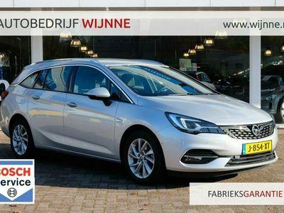 tweedehands Opel Astra 1.2 Turbo 145pk 6-bak Sports Tourer Elegance | Navi | LED | Climate | PDC | Rijstrooksensoren