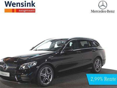 tweedehands Mercedes 200 C-Klasse EstateBusiness Solution AMG van €56.190,- voor €54.150,- | Panorama schuifdak | Achteruitrijcamera | Privacy Glass | Metallic Grafietgrijs
