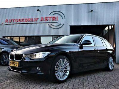 tweedehands BMW 330 330 Touring d High Executive [ leder | xenon | navi