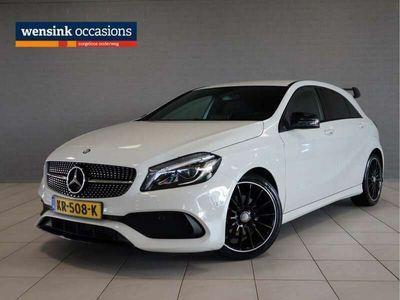 tweedehands Mercedes A160 AMG Night Edition | LED koplampen | Navigatie | Cruise control | Autotelefoonvoorbereiding met bluetooth | AMG-styling | AMG Line | Regensensor |