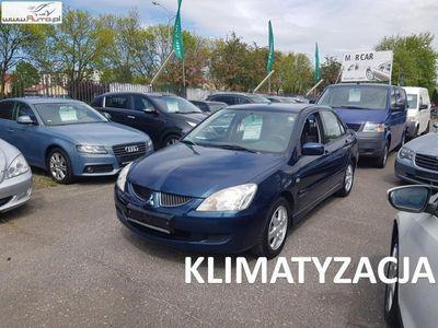 używany Mitsubishi Lancer 1.6dm3 98KM 2005r. 137 437km 1.6 Benzyna 98 KM, Klimatyzacja, Alufelgi, Bluetooth, Radio CD MP3 USB