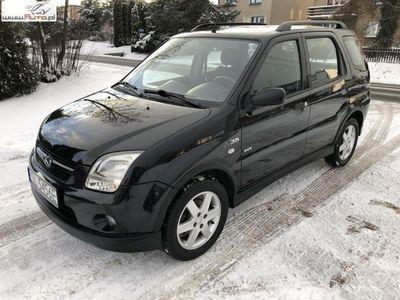 używany Suzuki Ignis 1.5dm3 99KM 2005r. 125 000km 1,5 99KM Klima Podgrzewane fotele Koła zima/lato