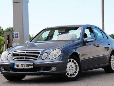 używany Mercedes E240 1.8dm 163KM 2004r. 179 257km