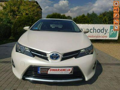 używany Toyota Auris 2013*HYBRYDA*biała perła*smartkey*sam parkuje*ISOFIX II (2012-)