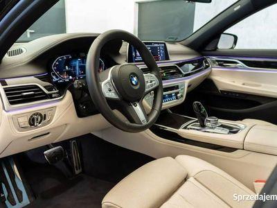 używany BMW 750 3dm 400KM 2019r. 4 350km