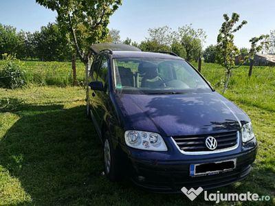 second-hand VW Touran 1.6 FSI Schimb