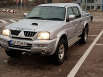 used Mitsubishi L200 Volan dreapta, 2006.