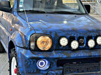 second-hand Suzuki Jimny / 4x4 cu reductor / suprainaltat