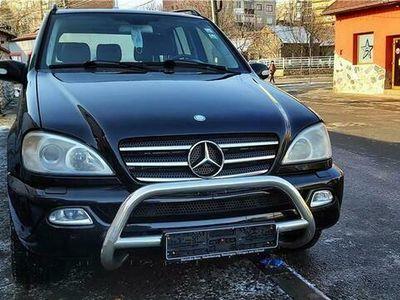 second-hand Mercedes ML400 Automatic, Climatronic, Navi, DVD, 2004, 255000km, 4990 Euro sau RATE FIXE