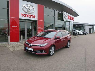 begagnad Toyota Auris Touring Sports Hybrid Intense Edition