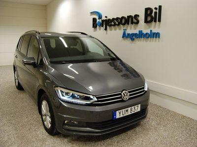 begagnad VW Touran 1,5 TSI EVO 150 DSG7 2019, SUV 279 900 kr