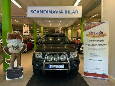 begagnad Nissan Navara Dubbelhytt 2.5 dCi 4x4 Auto FULLURUSTAD 174hk