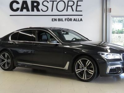 begagnad BMW 750 d xDrive M - Sport / Laser / Värmare / Drag