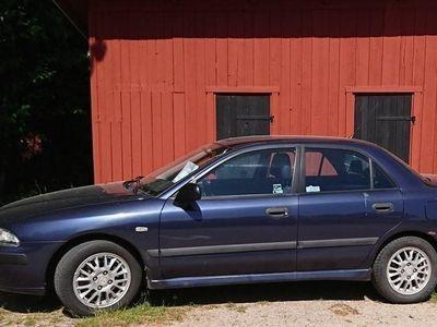 begagnad Mitsubishi Carisma Sedan