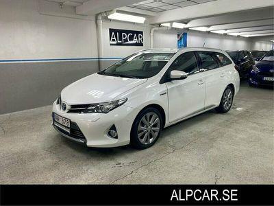 begagnad Toyota Auris Touring Sports Hybrid TS EXECUTIVE PEARL V+S HJUL