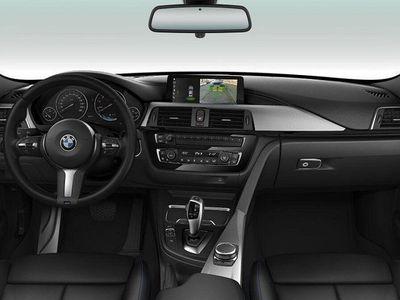begagnad BMW 320 i xDrive iA Touring M Sport
