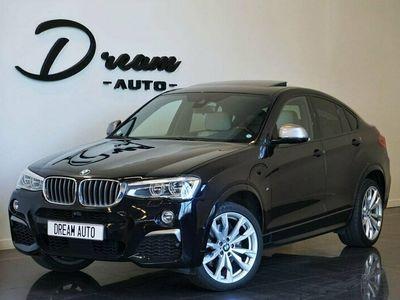 begagnad BMW X4 M40i CARBONSVART 360HK