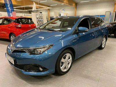 begagnad Toyota Auris Touring Sports Hybrid Hyb 1.8 VVT-i + 3JM CVT Comfort