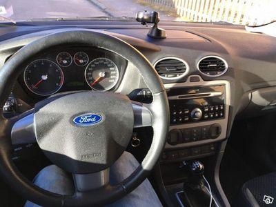 begagnad Ford Focus Kombi 1.8 Flexifuel Titanium -06