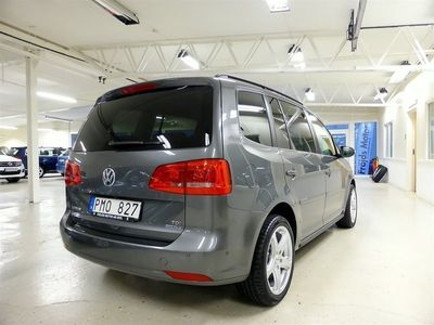 begagnad VW Touran TDI 105 hk 7-sitsig Travelpaket Drag GPS Svensksåld
