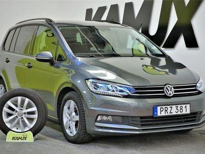begagnad VW Touran 1.6 TDI Pluspaket 7-sits Navi D-värm (115hk)