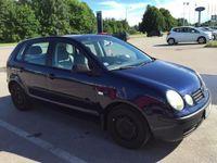 begagnad VW Polo 1,4 -03