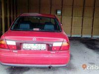 begagnad Mazda 323 1.5